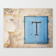 Vibrant Blue Window in Stone Wall Canvas Print