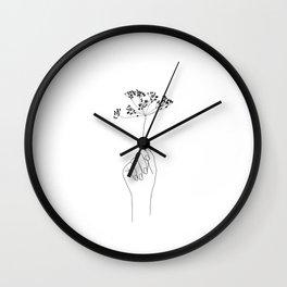 Hand holding flower illustration - Juliette Wall Clock