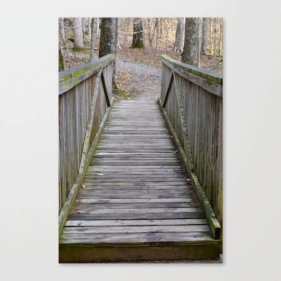 Walking over the bridge and through the woods Canvas Print