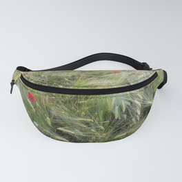 Red poppies in a wheat field. Fanny Pack