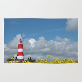 Happisburgh Lighthouse surrounded by Yellow flowering Oil Seed Rape Rug