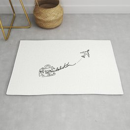 Wanderlust hand writing with a travel luggage and airplane Rug