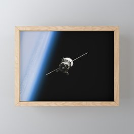 997. Backdropped by the blackness of space and Earth's horizon, the Soyuz TMA-6 spacecraft approaches the International Space Station Framed Mini Art Print