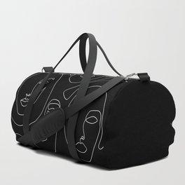 Faces in Dark Duffle Bag