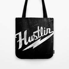 Hustlin - Black background with white image Tote Bag