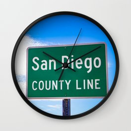 Closeup of the San Diego County Line Sign against a Blue Sky in the Anza Borrego Desert State Park Wall Clock