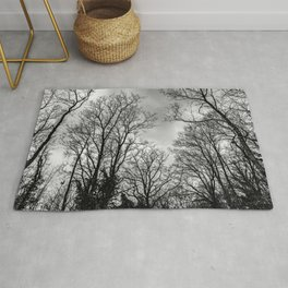 Black and white haunting trees Rug