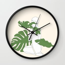 Woman with Monstera Leaves Wall Clock