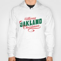 oakland Hoodies featuring Merry Oakland Christmas by Keeley Marie