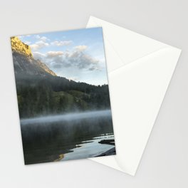 Misty Lake Portrait wide angle with boathouse. Amazing shot of a wooden house in the Ferchensee lake in Bavaria, Germany, in front of a mountain belonging to the Alps. Scenic foggy morning scenery at sunrise. Stationery Cards