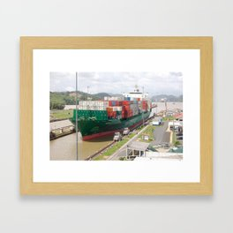 A cargo ship crossing the Miraflores locks at the Panama Canal Framed Art Print