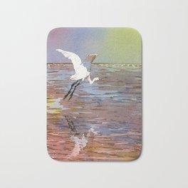 Jamaican crane flying over water in Montego Bay.  Watercolor painting crane art bird Jamaica Bath Mat