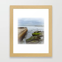 When the tide goes out, a briny soup is trapped among the rocks Framed Art Print
