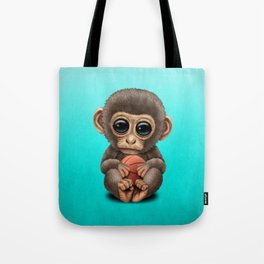 Cute Baby Monkey Playing With Basketball Tote Bag