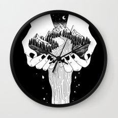 the world in my hand Wall Clock