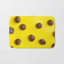 Chestnut pattern on yellow background, ripe chestnuts Bath Mat