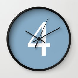 number four sign on placid blue color background Wall Clock