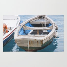 Little fishing boat, blue sea Rug