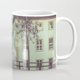 Colorful low rise residences in a town Coffee Mug