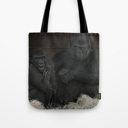 Gorilla Mother Has Her Cheeky Son By The Scruff Of His Neck Tote Bag