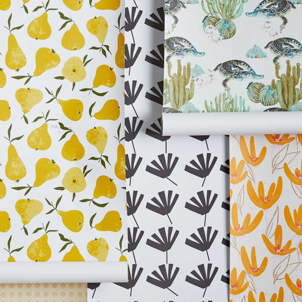 rolls of removable wallpaper with floral and fruit patterns