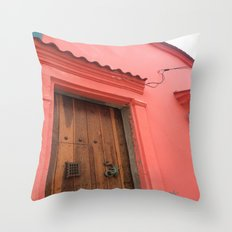 Cartagena is Peachy, Colombia, South America. Coral Pink Building with Ornate Lizard design Throw Pillow