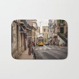 Tram 28 transports tourists through Alfama district in Lisbon, Portugal Bath Mat