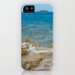 Pathway on the typical rocky beach in Istria, Croatian coast. Blue transperent sea and sky. iPhone Case
