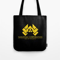 die hard Tote Bags featuring DIE HARD - Nakatomi Corporation, Los Angeles by La Cantina