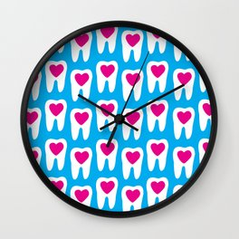 Teeth pattern with hearts in the center on blue background Wall Clock