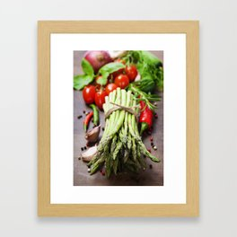 Fresh green asparagus bunch and vegetables on wooden board Framed Art Print