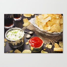 Potato chips with dipping sauces on a rustic table Canvas Print
