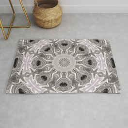A Pearl and Black Onyx Abstract Mandala of Plunged Daggers, Hearts and Flowers Rug