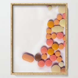 Numerous colorful pills on white background. Serving Tray