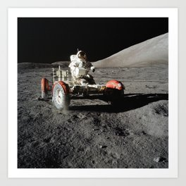Astronaut Eugene A Cernan commander drives the Lunar Roving Vehicle during first Apollo 17 extravehi Art Print