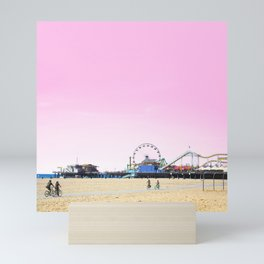 Santa Monica Pier with Ferries Wheel and Roller Coaster Against a Pink Sky Mini Art Print
