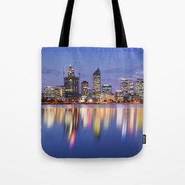 Skyline of Perth, Australia across the Swan River at night Tote Bag