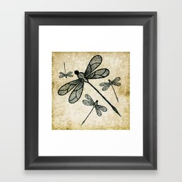 Dragonflies on tan texture Framed Art Print