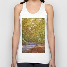 Remote country road through Autumnal woodland. Norfolk, UK. Unisex Tank Top