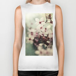 Spring blossom on rustic wooden table Biker Tank