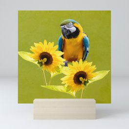 Blue-and-yellow macaw and sunflowers Mini Art Print