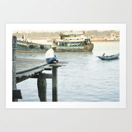 Birmese man sitting on a pier on the Yangon River, Myanmar Art Print