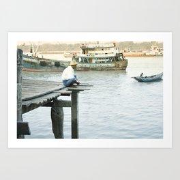 Birmese man sitting on a pier on the Yangon River, Myanmar Art Print