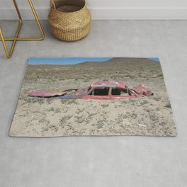 Car in a sea of sand Rug