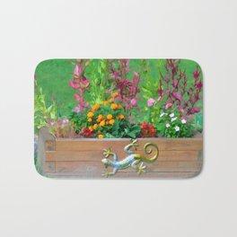 Flowers in a wooden flower bed Bath Mat