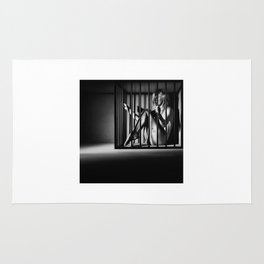 Nude Woman locked in a steel cage Rug