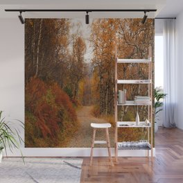 Winding country road in a fall forest Wall Mural