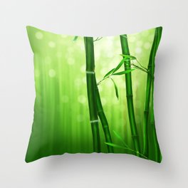 Bamboo Stalks with a Green Bokeh Background Throw Pillow