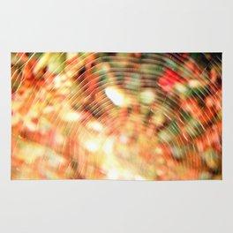 Cobweb with flowers behind Rug