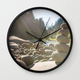 Cairn of stacked rocks along banks of Oregon river Wall Clock